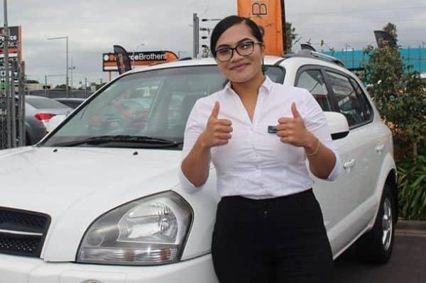 Kamela with her car