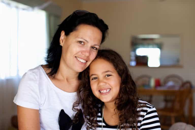 Mum and daughter smiling