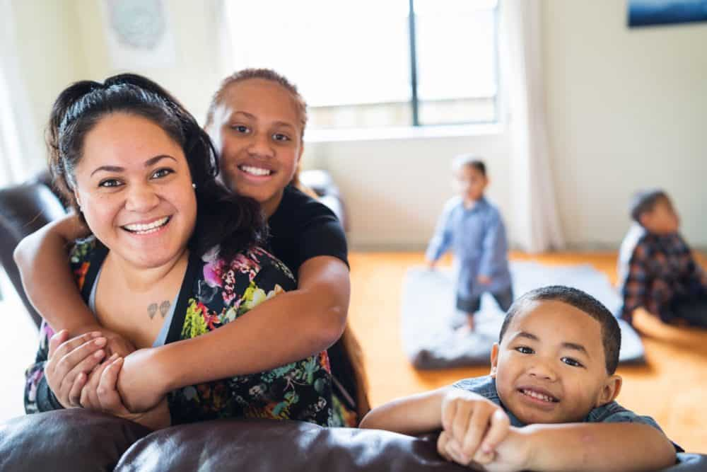 Maori mother spending quality time with kids at home in Auckland, New Zealand.