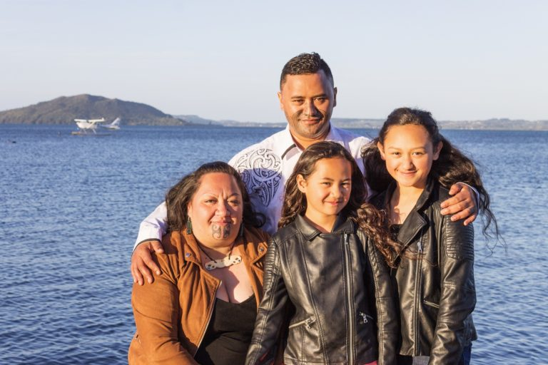 Portrait of a young Maori family taken outdoors