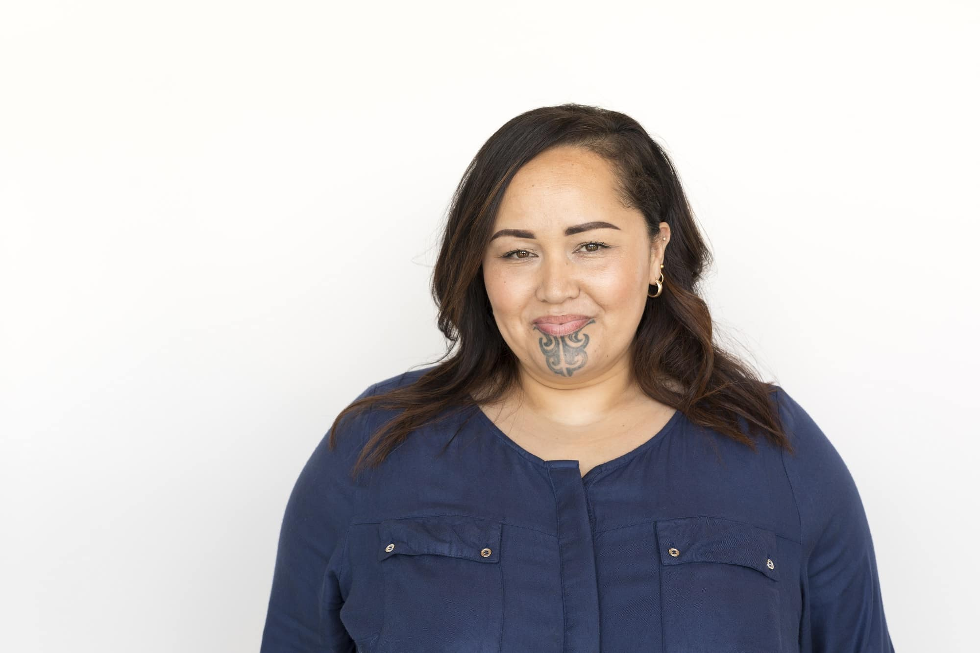 Portrait on a White Background of a Maori Woman With a Face Tattoo or Moko