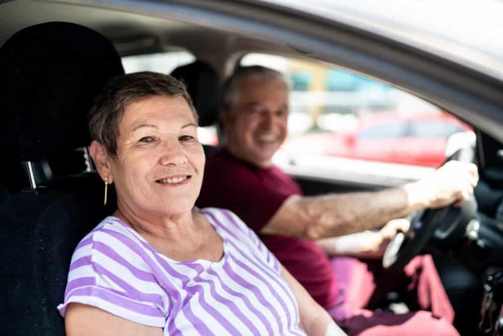 Portrait of senior couple inside a car