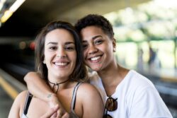 Portrait of Young Lesbian Couple at Subway Station