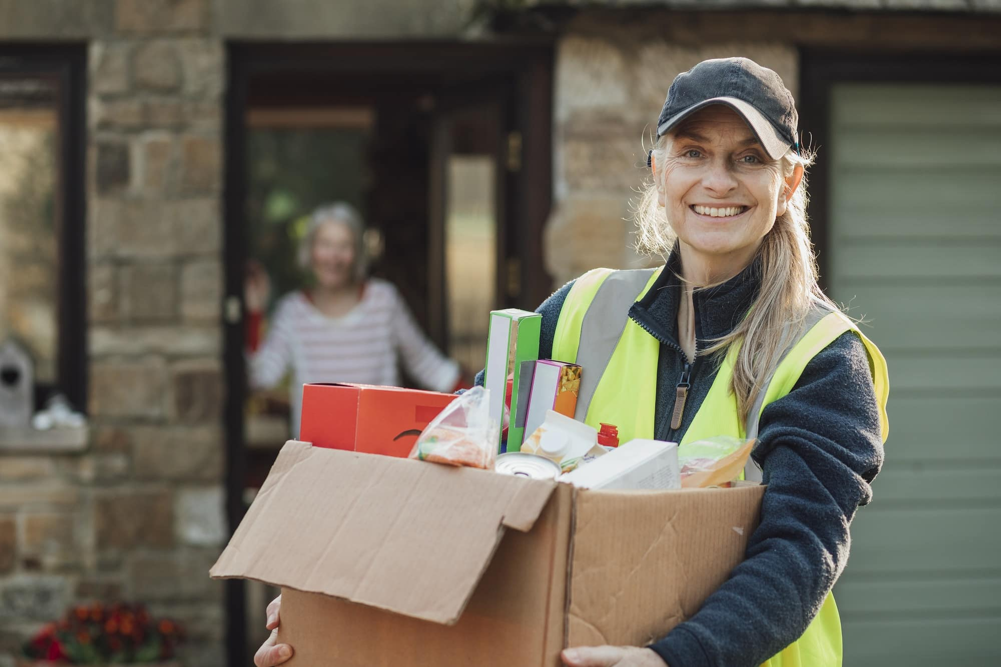 Shot of a Caucasian mature woman delivering groceries in Northumberland.